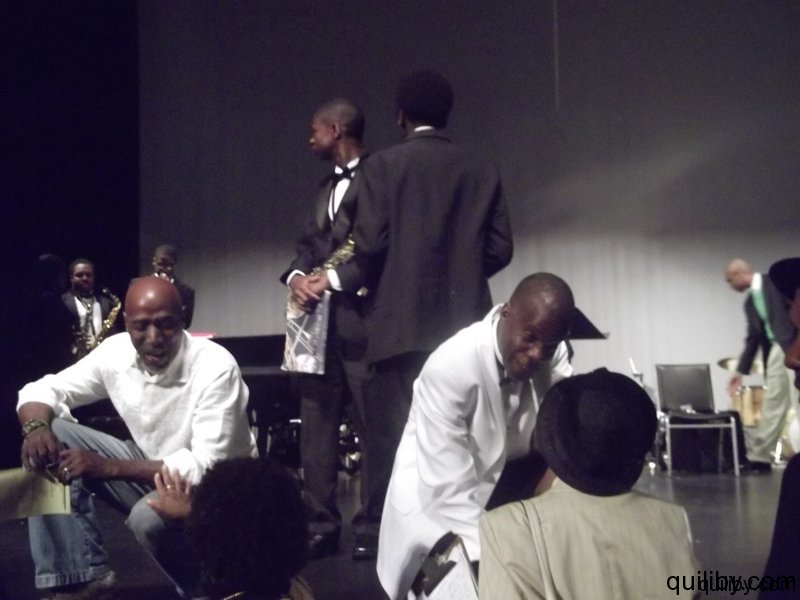Band Director Mr. Petty and T.S. Monk chat with members of the audience.