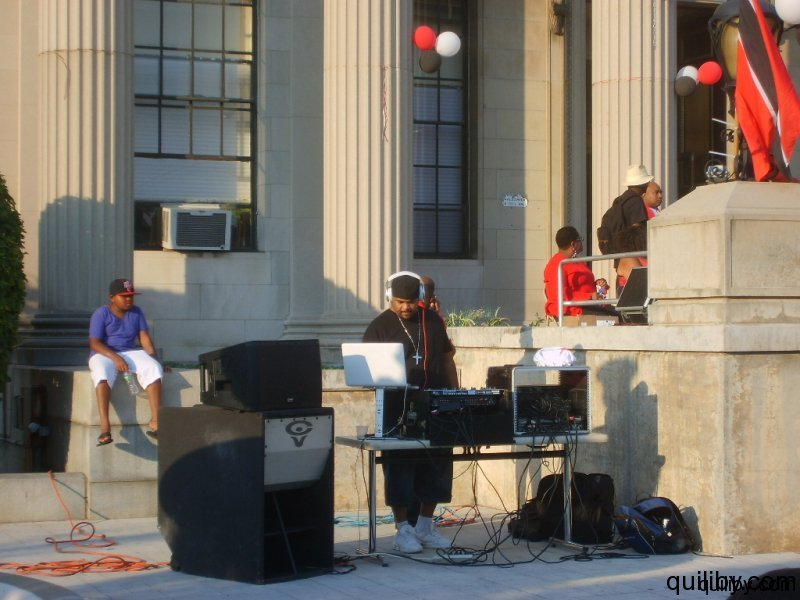 DJ keep crowd entertained with calypso and soca.